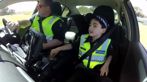 The 10-year-old was at home in the Highway Patrol car. (9NEWS)