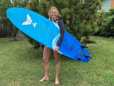 Lorraine holding surf board