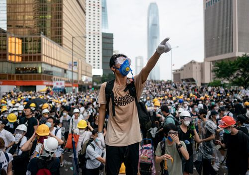 A protester makes a gesture during a protest in Hong Kong. Large crowds of protesters gathered in central Hong Kong as the city braced for another mass rally in a show of strength against the government over a divisive plan to allow extraditions to China.