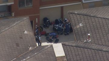 A boy has been taken to hospital after falling from a building in south Sydney.
