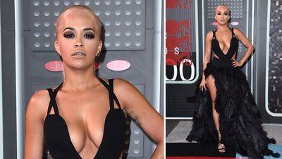 UK singer Rita Ora showed off leg and a plunging neckline in her black dress. (AAP)