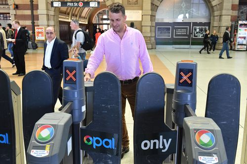 Andrew Constance goes through an Opal Card turnstile after a press conference at Central Station last year. Picture: AAP