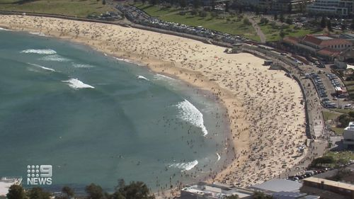 Thousands flocked to Sydney beaches despite surge in COVID-19 numbers in some city suburbs.