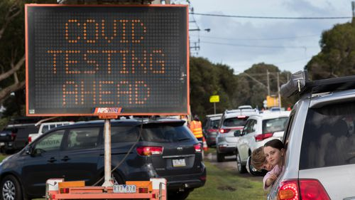 People wait for virus testing in Melbourne