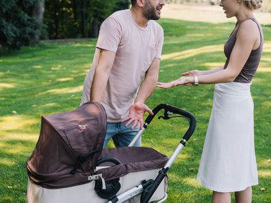 Couple fighting over baby in pram.