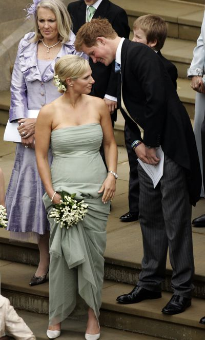 Zara Phillips laughs with Prince Harry as a bridesmaid at the wedding of Peter Phillips to Autumn Kelly, at St George's Chapel in Windsor Castle on May 17, 2008