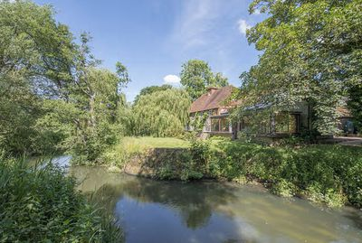 Situated in West Sussex, England, the house is a former 18th century water mill with additional cottage (built in the 17th century) and spa complex complete with indoor and outdoor pools.