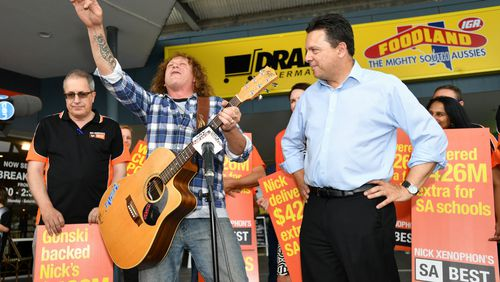 Nick Xenophon and Dave Gleeson from the Screaming Jets outside the Newton Shopping Centre. (AAP)