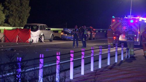 A woman has died after allegedly being struck by a car while assisting motorists navigating road debris in rural Melbourne.