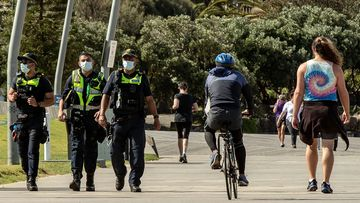 Public Service Officers patrol at St Kilda beach on October 03, 2020 in Melbourne, Australia