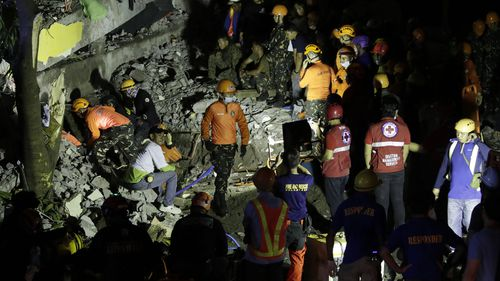 Emergency responders continue search operations at a damaged commercial building following an earthquake in Porac town, Pampanga Province, north of Manila, Philippines.