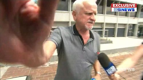 The man hurled abuse and threw punches at the camera crew. (9NEWS)