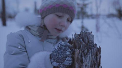 A Norilsk child looks at a tree damaged by acid rain