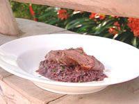 Raddiccio and red wine risotto with lamb loins in prosciutto