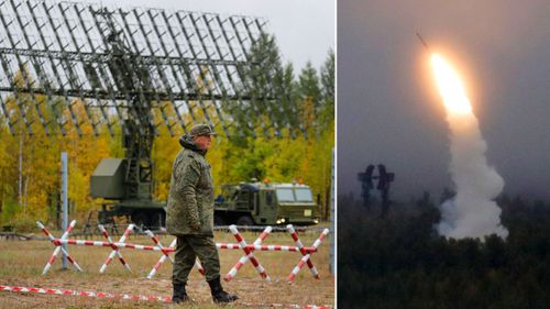 Russian soldiers, right, fire an air defence missile monitored by a mobile radar unit.