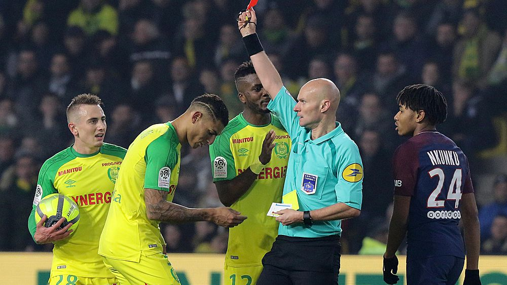 Referee kicks out, provisionally suspended