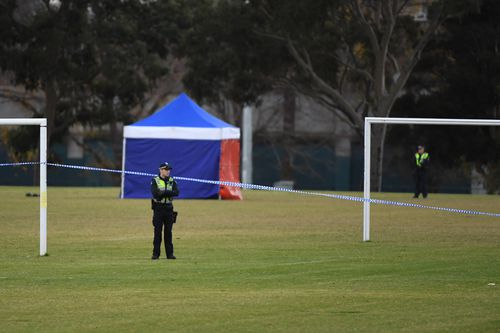 Detective this morning search the field extensively for clues. Picture: AAP