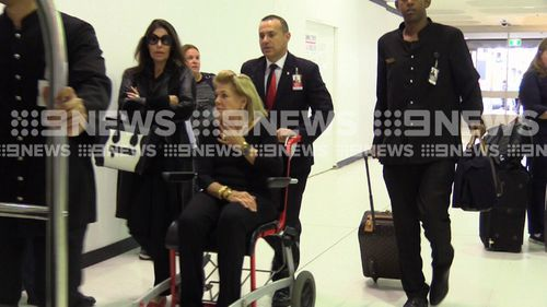 Ms Packer was wheeled to her gate by airline staff. (9NEWS)