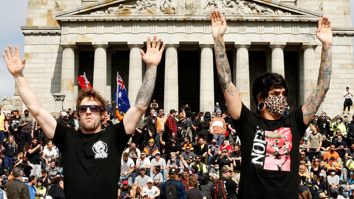 Protesters are seen at the Shrine of Remembrance on September 22, 2021 in Melbourne, Australia. Protests started on Monday over new COVID-19 vaccine requirements for construction workers but turned into larger and at times violent demonstrations against lockdown restrictions in general. Melbourne is currently subject to COVID-19 lockdown restrictions, with people only permitted to leave home for essential reasons. (Photo by Darrian Traynor/Getty Images)