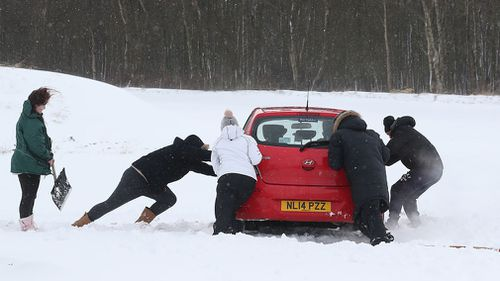 The freak weather event has hit so strongly, many across the UK and Europe have been stranded in their cars (AAP).