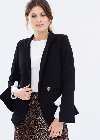 "Rebecca Vallance flare-sleeved blazer, $799 at <a href=""https://www.theiconic.com.au/beltran-flare-sleeve-blazer-455785.html"" target=""_blank"">The Iconic<br /> </a>"