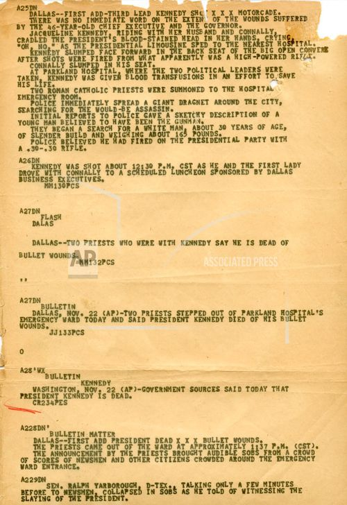 Newspaper wire copy reporting on the assassination of US President John F Kennedy. (Associated Press)