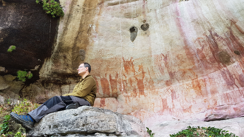 José Iriarte, professor of Archaeology at Exeter, at a wall depicting mastadons in the Amazon rainforest.