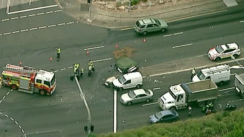 It is believed the car collided with a truck. (9NEWS Choppercam)