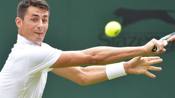 Bernard Tomic in action during his second round match at Wimbledon. (AAP)