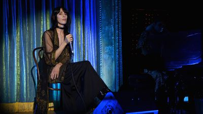 <p>Model and musician Jamie Bochert, who walked in the Marc Jacobs Resort show just last week, performs for guests.</p>
