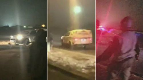 Locals hurled rocks at the police car. Picture: 9NEWS