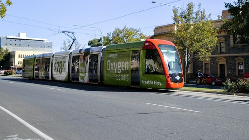 Trams like this one in Adelaide could soon be transporting passengers from the airport.