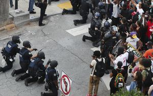 Gallery: Police kneel before protesters in US