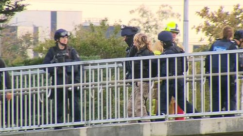 A woman in her 50s has been arrested after staging a protest over the Monash Freeway. (9NEWS)