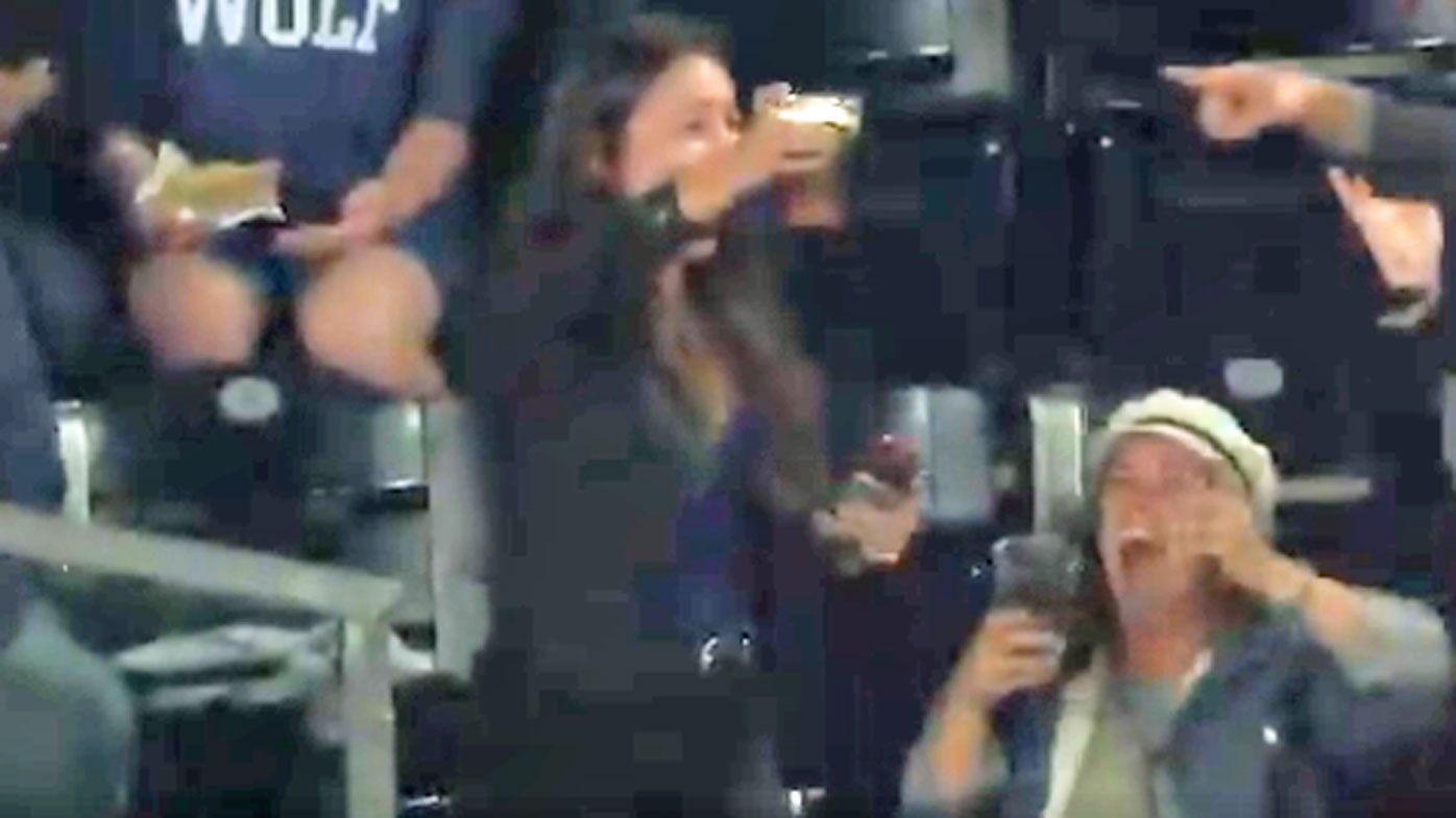Baseball fan catches foul ball with beer cup