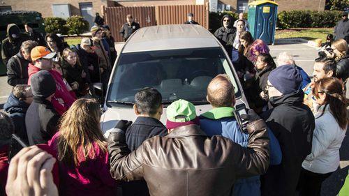 Demonstrators surrounded a government van to prevent Samuel Oliver-Bruno's deportation.