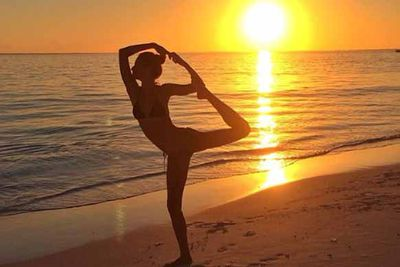 Gisele proved her exercise routine doesn't stop even when on holiday. Sunset yoga anyone?