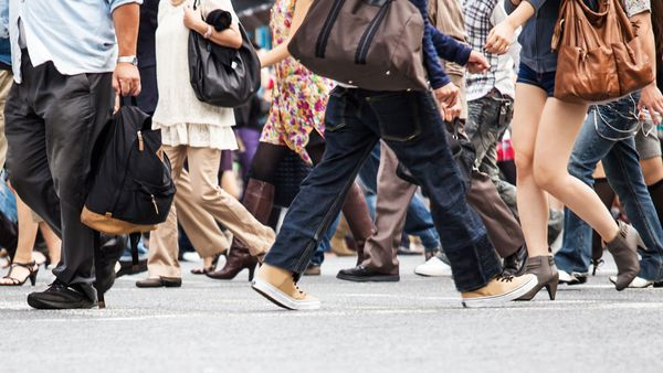 Crowd walking through city