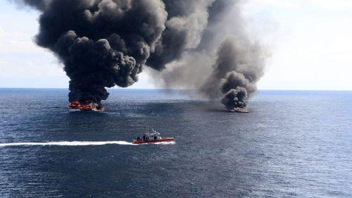 The US Coast Guard sets drug-smuggling vessels alight.