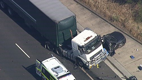 A truck and car crash has closed lanes on the M5.