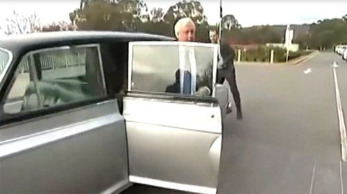 Clive Palmer Rolls up to parliament
