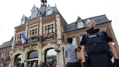 Police stand guard outside the Saint-Etienne-du-Rouvray's city hall. (AFP)