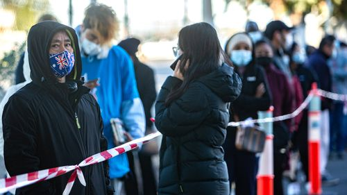 People queue for the COVID-19 vaccine at the Sunshine Hospital vaccination hub, in Victoria.