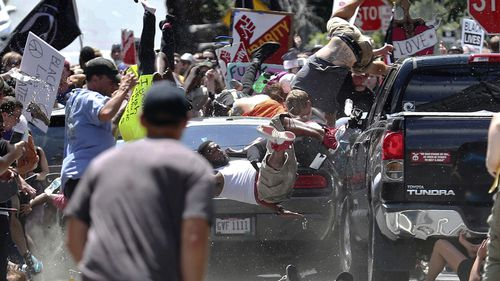 Protesters fly through the air as Fields' car ploughs into the crowd.
