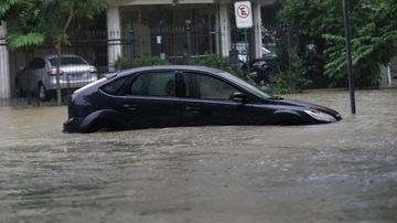 An abandoned vehicle sits in floodwaters. The mayor is calling for hundreds of millions of Brazilian reals to fund better flood preparedness. (Silvia Izquierdo/Associated Press)