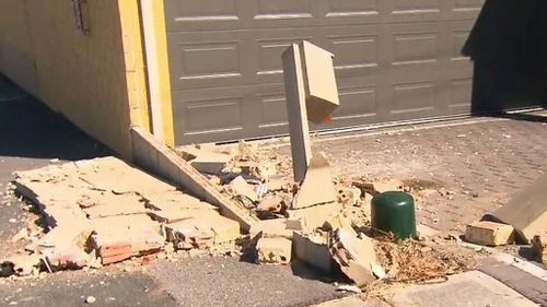 The car hit a postbox before smashing into a small brick wall.