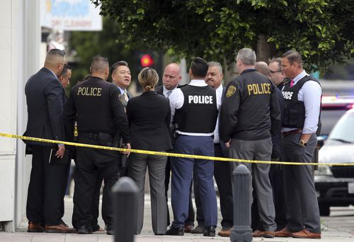 Authorities say two police officers and a suspect were shot after reports of a man with a sword entering the Church of Scientology in Inglewood.(AP Photo/Reed Saxon)