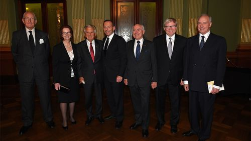 Former Prime Ministers of Australia (L-R), Malcolm Fraser, Julia Gillard, Bob Hawke, Prime Minister Tony Abbott, John Howard, Kevin Rudd and Paul Keating assemble for a photograh at the completion of the memorial service for former Prime Minister, Gough Whitlam, at the Town Hall in Sydney on Wednesday, Nov. 5, 2014. (AAP)