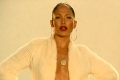 JLo got all sexy and suave in designer gear in 'Jenny from the Block' in 2001.