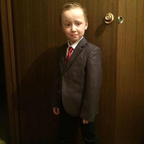 Seven-year-old Jack wearing his first suit.